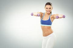 Young woman exercise with dumbbells on white backgroun Stock Images