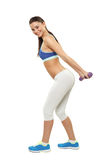 Young woman exercise with dumbbells on white backgroun Stock Photography