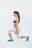 Young woman exercise with dumbbells on white backgroun Royalty Free Stock Images