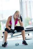 Young woman exercise with dumbells Royalty Free Stock Photography