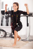 Young woman exercise on electro stimulation machine Royalty Free Stock Image