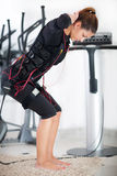Young woman exercise on electro stimulation machine Stock Photos