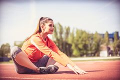 Young woman exercise. On the move. Outdoors image. Close up image Stock Photo