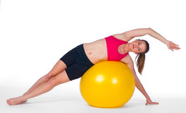 Young woman exercise on pilates ball Stock Photos