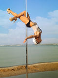 Young woman exercise pole dance. Stock Photography