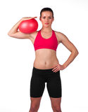 Young woman exercise with red ball Stock Photo