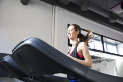 Young woman exercise on the treadmill Royalty Free Stock Photos