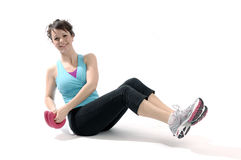 Young woman exercises Royalty Free Stock Image