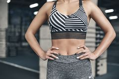 Young woman exercises in gym healthy lifestyle standing confident Royalty Free Stock Image