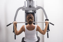 Young woman exercises in a gym Royalty Free Stock Image