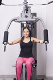 Young woman exercises in a gym Royalty Free Stock Photography