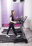 Young woman exercises in a gym Stock Photos