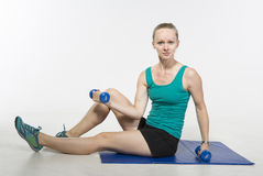 Young woman exercises Royalty Free Stock Photos