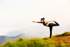 Young woman exercises yoga Royalty Free Stock Photography
