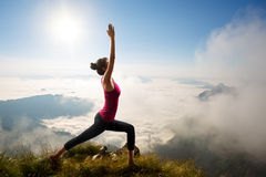 Young woman exercises yoga Royalty Free Stock Image