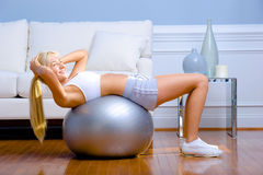 Young Woman Exercising Royalty Free Stock Photography