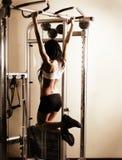 Young woman exercising Royalty Free Stock Photos