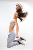 Young woman exercising. Aerobic instructor exercising in studio Royalty Free Stock Photo