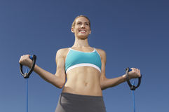Young Woman Exercising Stock Photo