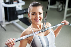 Young woman exercising back muscles Royalty Free Stock Photography