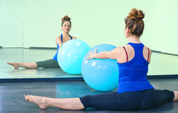 Young woman exercising with a ball Stock Images
