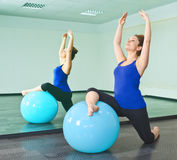 Young woman exercising with a ball Royalty Free Stock Photography