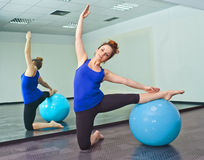 Young woman exercising with a ball Royalty Free Stock Image