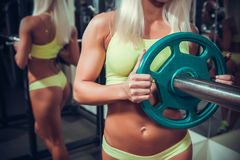 Young woman exercising with barbell Royalty Free Stock Photography
