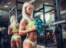 Young woman exercising with barbell Royalty Free Stock Photo
