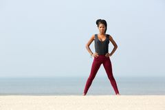 Young woman exercising at the beach Stock Images