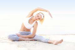 Young woman exercising on the beach Royalty Free Stock Image