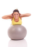 Young woman exercising on the big gray ball Royalty Free Stock Photos