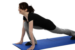 Young woman exercising on blue mat Stock Photography