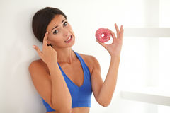 Young woman in exercising clothes choosing food Stock Images