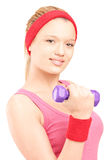 Young woman exercising with a dumbbell Stock Images