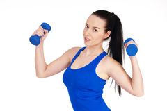 Young female with dumbbells Royalty Free Stock Image
