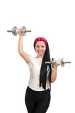 Young woman exercising with dumbbells Stock Image