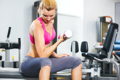 Young woman exercising. With dumbbells in gym Royalty Free Stock Photo