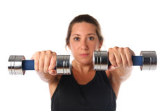 Young woman exercising with dumbbells Royalty Free Stock Image