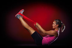Young woman exercising with elastic fitness band Royalty Free Stock Images