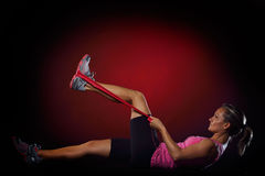Young woman exercising with elastic fitness band Royalty Free Stock Photo