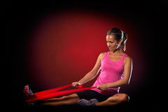 Young woman exercising with elastic fitness band Royalty Free Stock Image