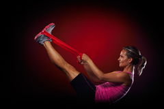 Young woman exercising with elastic fitness band Royalty Free Stock Photos