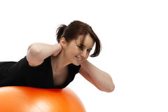 Young woman exercising with exercise ball Royalty Free Stock Photos