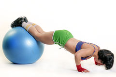Young woman exercising with fit-ball Stock Photos