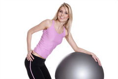 Young woman exercising on fitness ball Royalty Free Stock Photos