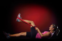 Young woman exercising with fitness band in the gym Royalty Free Stock Images