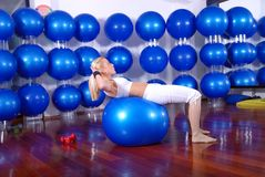 Young woman exercising in a fitness center Royalty Free Stock Photography