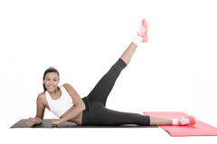 Young woman exercising on floor Royalty Free Stock Images