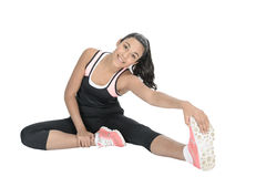 Young woman exercising on floor Royalty Free Stock Photos